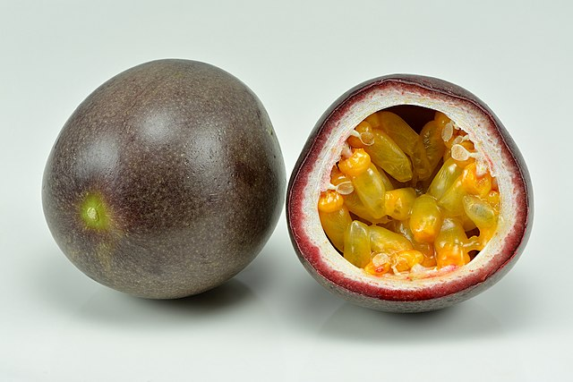 Passion fruits – whole and halved. Credit: Ivar Leidus / Wikimedia